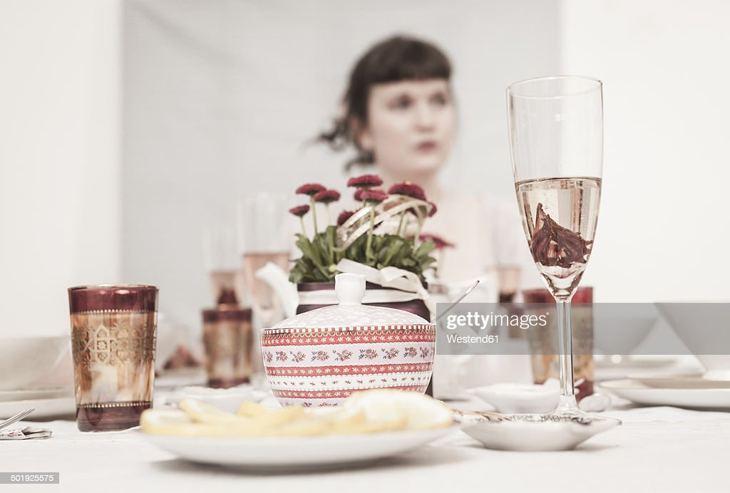 Young woman on a retro style tea party
