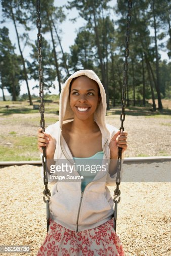 Young woman on a swing : Stock Photo