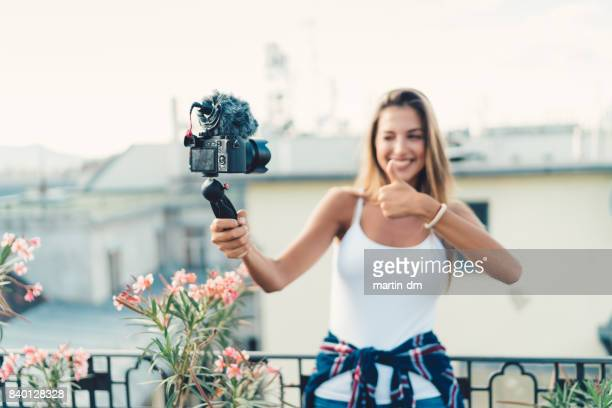 Young woman on a vacation vlogging