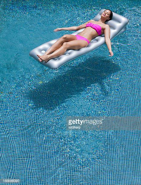 Young woman on air bed