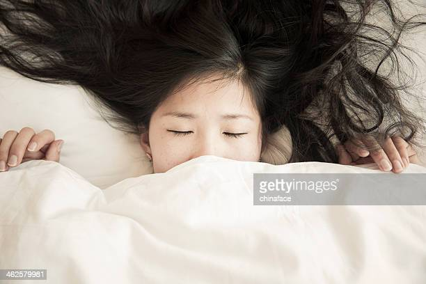 young woman on bed.