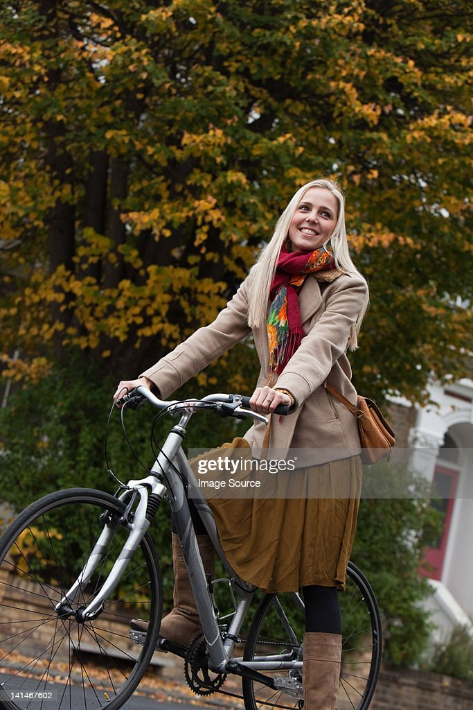 Young woman on bicycle : Stock Photo
