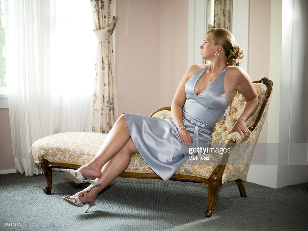Young woman on chaise longue stock photo getty images for Chaises longues tressees
