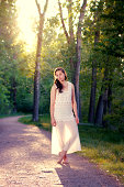 Young woman on dirt path at golden hour