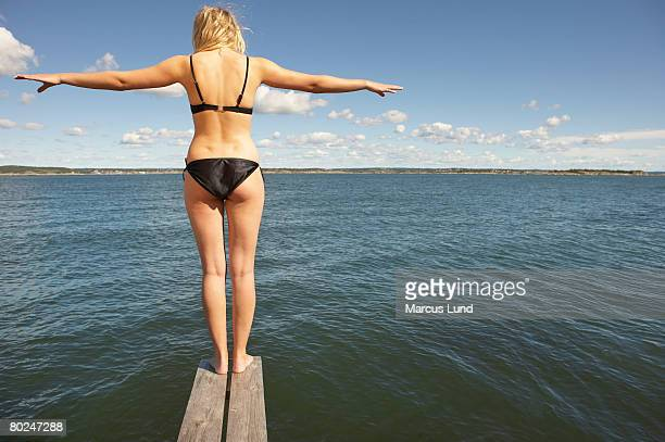 Young woman on diving platform.