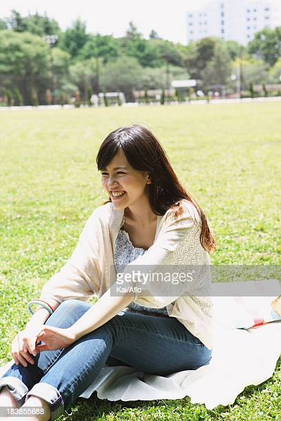 Young woman on grassland smiling away