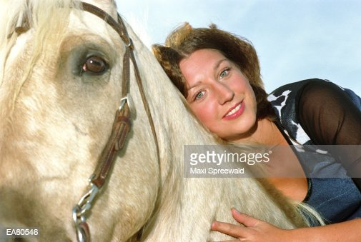 Young woman on horse, portrait, close-up : Stock Photo