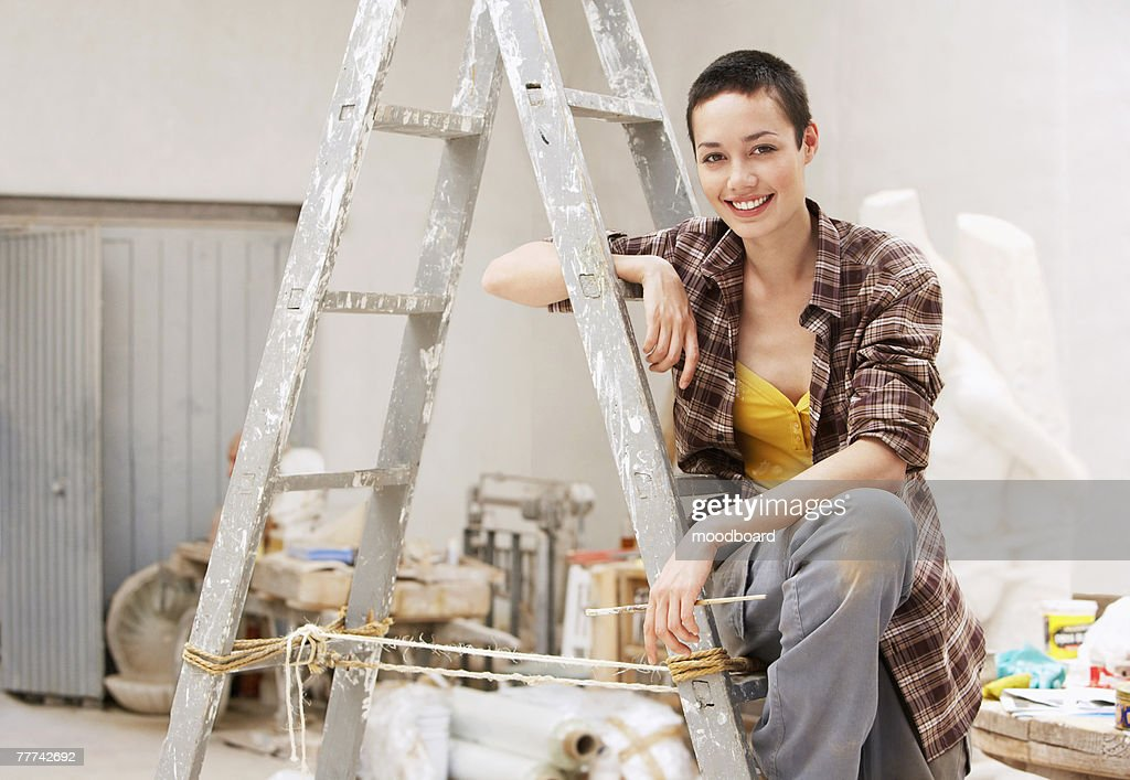 Young Woman on Ladder