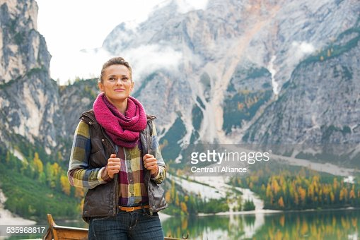 young woman on lake braies in south tyrol, italy : Stock Photo