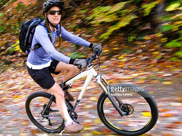 Young woman on mountain biking