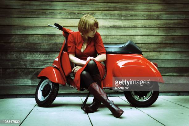 Young Woman on Red Vintage Retro Scooter
