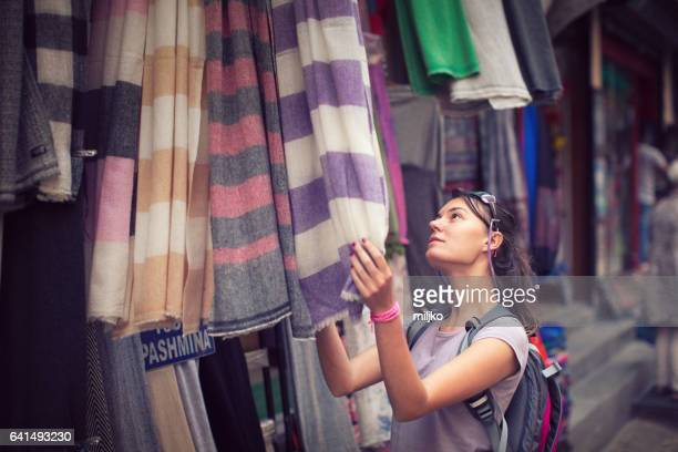 Young woman on street market shopping