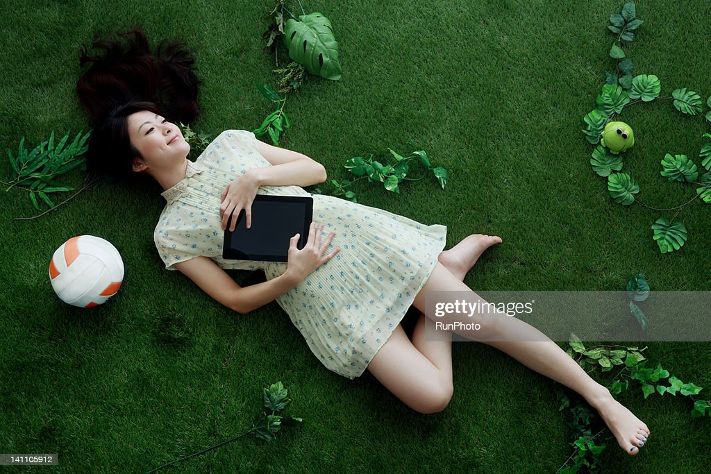 young woman on the green : Stock Photo