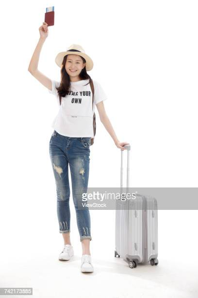 Young woman on travel with suitcase and passport