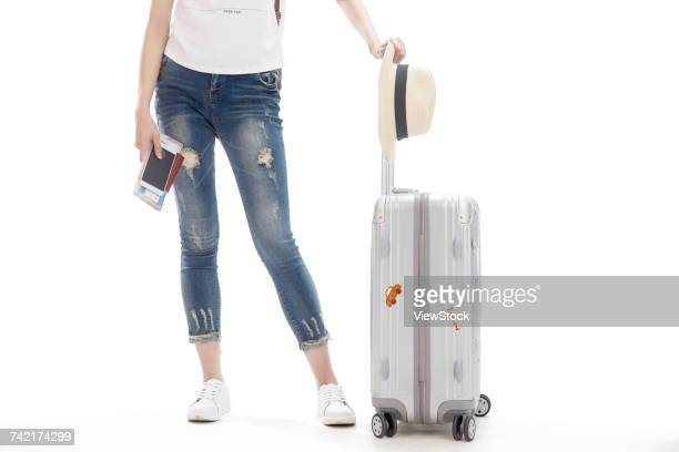 Young woman on travel with suitcase