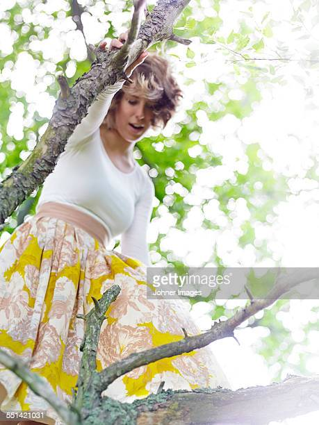 Young woman on tree