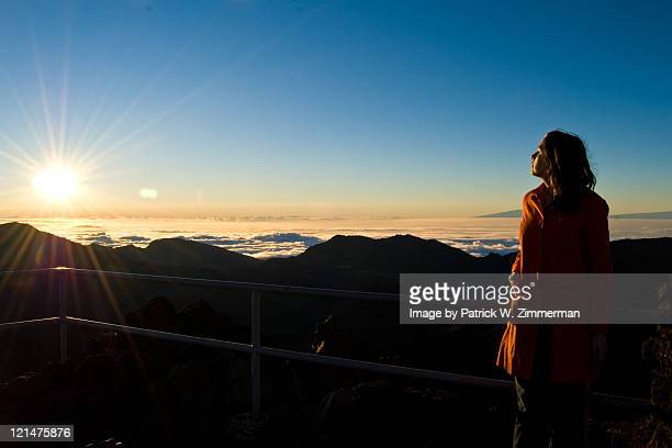 Young woman on volcano at morning