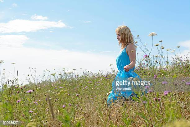Young woman on wildflower meadow