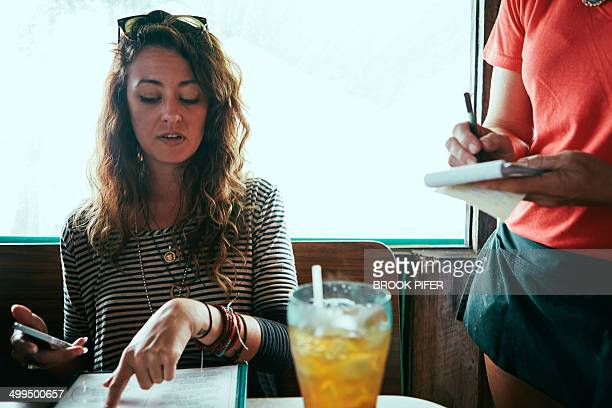 Young woman ordering at diner