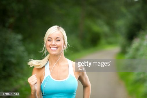 young woman out jogging : Stock Photo