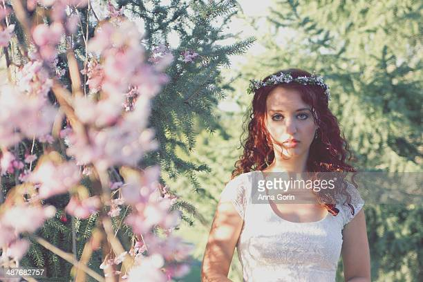 Young woman outdoors in spring with flower crown