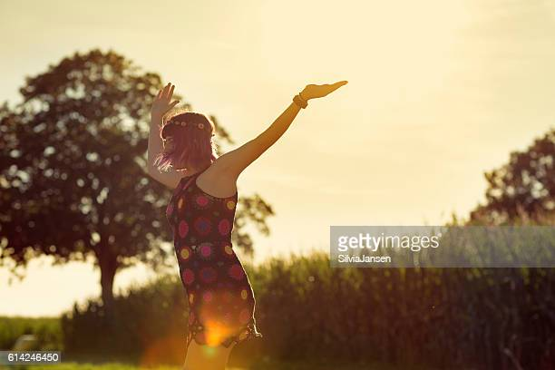 Young woman outdoors in summer happiness