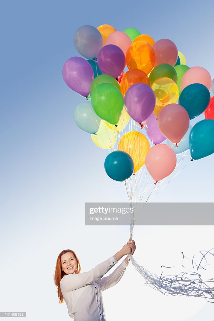 Young woman outdoors with balloons : Stock Photo