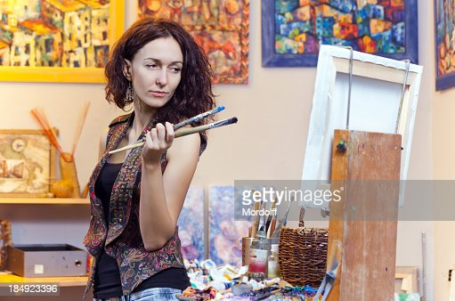 Young woman painting in his studio
