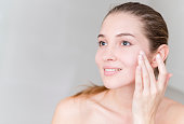 Young woman pampering her skin - beauty concepts