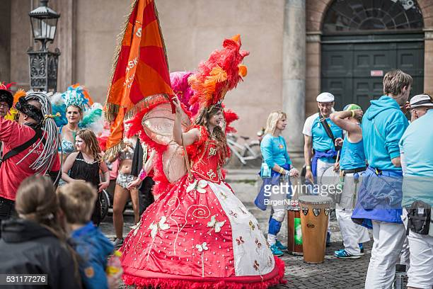 Young woman parading in the Copenhagen Whitsun Carnival, 2016.