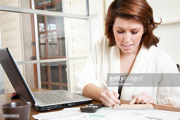 Young Woman Paying Bills at Home
