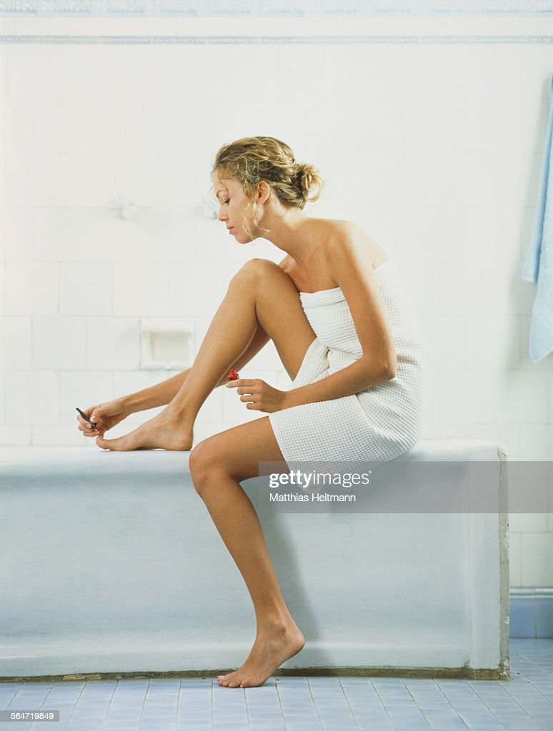 Young woman pedicuring : Photo