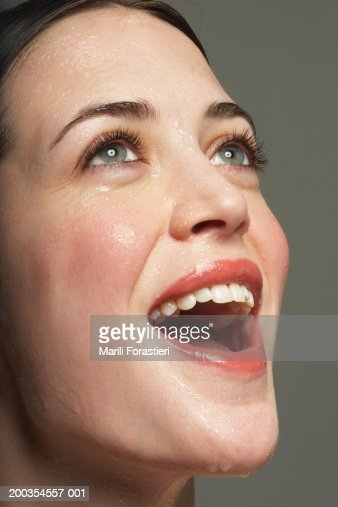 Young woman perspiring, laughing, close-up