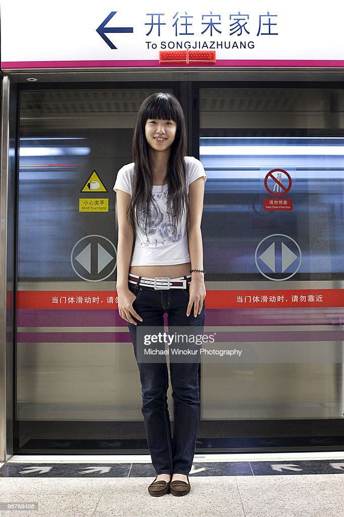 Young woman photographed in Beijing subway