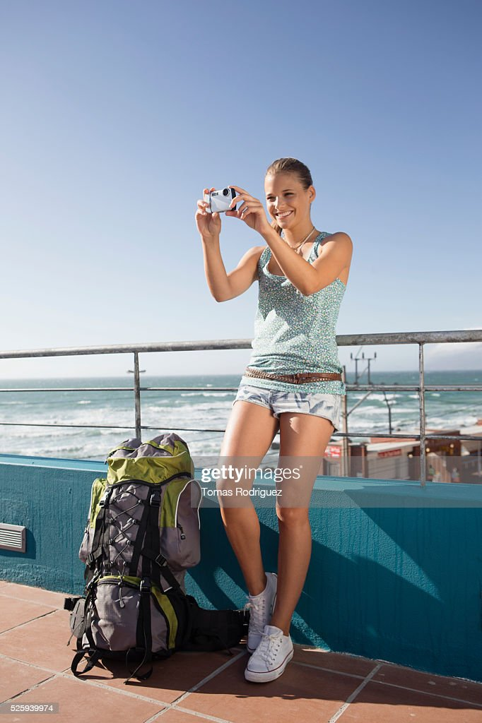 Young woman photographing herself during sea trip on ferry : ストックフォト