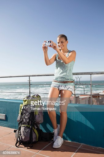 Young woman photographing herself during sea trip on ferry : Stock Photo