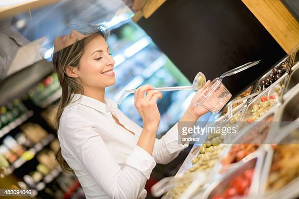 Young woman picking from a salad bar