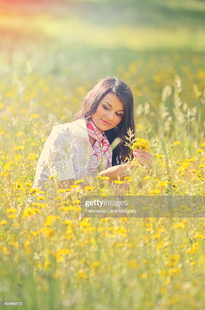 Young woman picking wildflowers