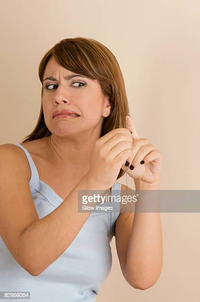 Young woman pinching her finger with a needle