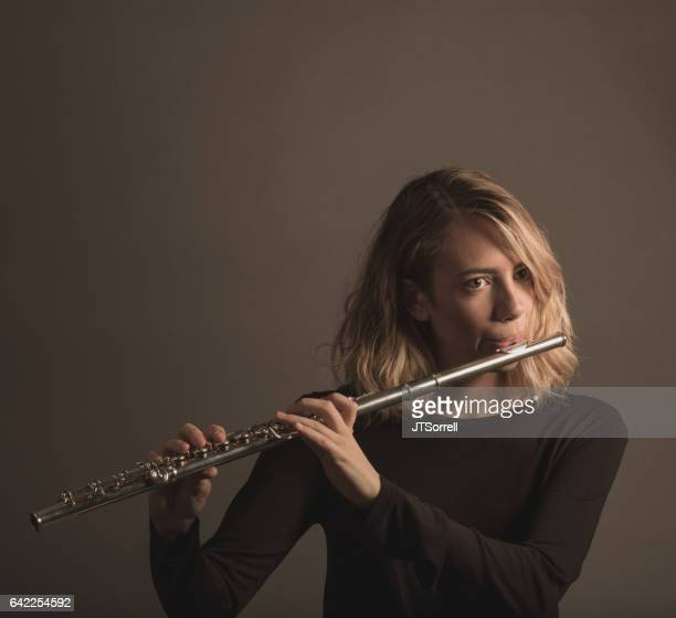 Young Woman Playing a Flute