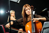 Young woman playing cello.