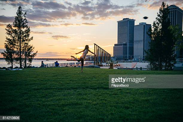 Young Woman Playing in Brooklyn Bridge Park