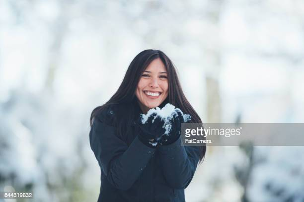 Young woman playing in snow
