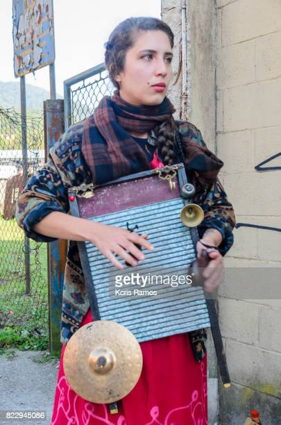 Young woman playing instrument in street of the village of paranapiacaba in brazil