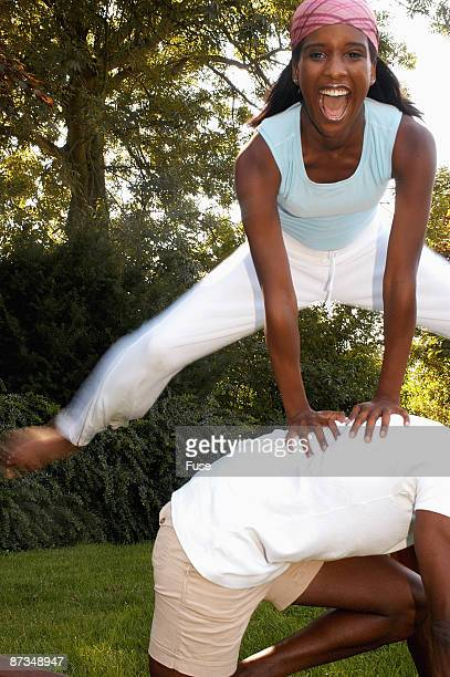 Young woman playing leapfrog