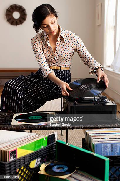 young woman playing records
