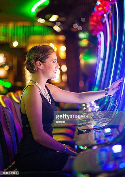 Young woman playing slot machines at the Casino