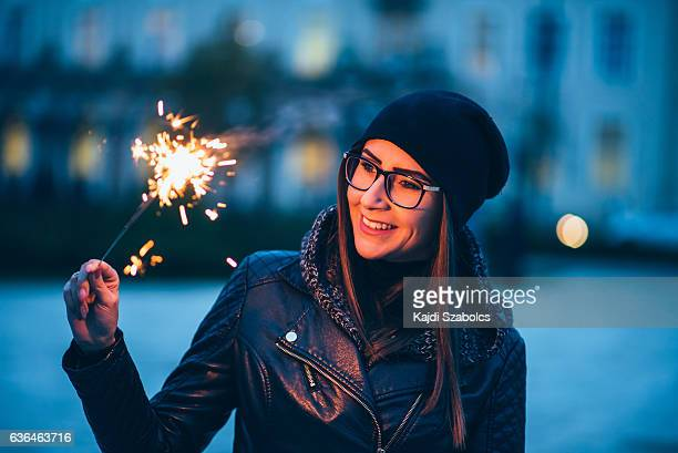 young woman playing sparkler
