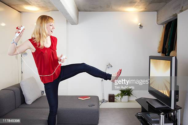 Young woman playing video game.