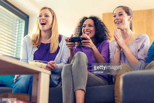 Young woman playing video game